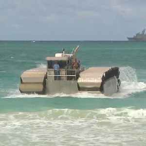 Amphibious military vehicle connects troops from ship to shore [Video]