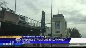 Redding locals wonder of parking structure encampment [Video]