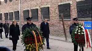 Merkel visits Auschwitz memorial for the first time after 14 years as Germany's Chancellor [Video]