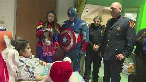 Police And Superheroes Bring Hospitalized Children Holiday Cheer [Video]