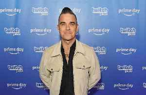 Robbie Williams admits that being middle aged has affected his songwriting [Video]