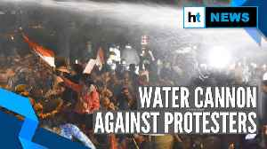 Unnao rape case: Police use water cannons on protesters marching in Delhi [Video]