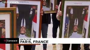 French climate activists hold stolen Macron portraits at protest [Video]