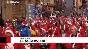 Glasgow's streets filled with Santas for annual charity run [Video]