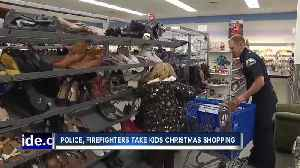 Police, firefighters take kids Christmas shopping [Video]