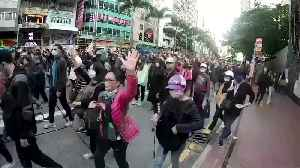 News video: Thousands march in Hong Kong as government urges calm