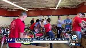 Firefighters build 200 bikes for area children [Video]