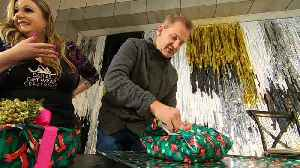Mike Max Faces Off Against Competitive Gift Wrapper [Video]