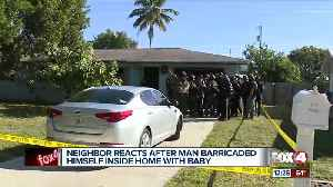Neighbors react after man barricaded himself inside home with baby [Video]
