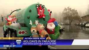 Holiday parade continues in Paradise despite rain [Video]