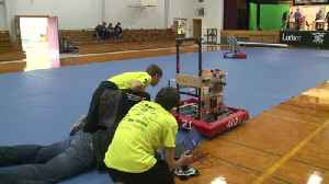 Local high school robotics teams get together for a day of learning and fun [Video]
