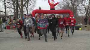 People dressed in ugly sweaters for annual fun run [Video]