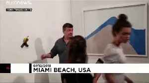 'Very tasty!': Watch moment artist eats $120,000 banana at Art Basel