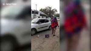 Stick-wielding men intercept car and attack passenger in northern India [Video]