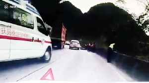 Chinese police officer jumps over wall to escape being crushed by oncoming truck [Video]