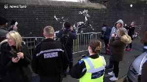 Police pose for pictures as they guard new Banksy artwork in Birmingham highlighting homelessness at Christmas [Video]