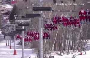 Hundreds of skiing Santas bring holiday cheer to Maine [Video]