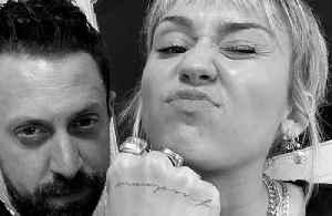 Miley Cyrus gets freedom tattoo [Video]
