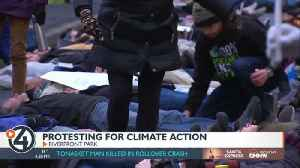 Crowd hosts strike, 'die-in' for climate change action [Video]