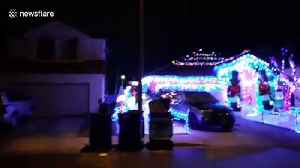 Extravagant Christmas light display on Las Vegas home [Video]