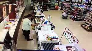 Bizarre moment robber punches shop assistant then stops to check he's OK [Video]