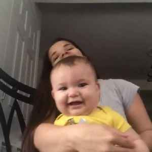 Baby Laughs Adorably When Mom Whispers In His Ears [Video]