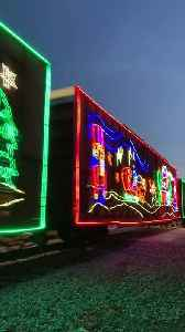 Train Beautifully Decorated With Christmas Lights Runs Carrying Passengers [Video]