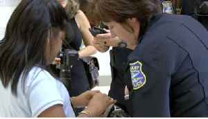 Stuart police officers, visually impaired students team up on special holiday mission [Video]