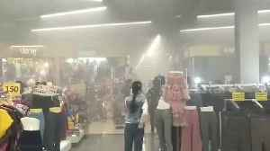 Shoppers flee after child's electric toy car explodes in department store [Video]