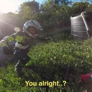 Kid Loses Control And Falls Off Track While Riding Dirt Bike [Video]