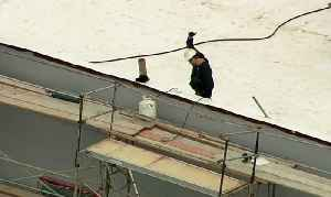 Raw Video: Suspect In Fremont Home Invasion On Roof Of Building Under Construction [Video]