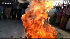 Tyres burned and police pelted with stones by protesters in Golaghat, India [Video]