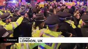 Anti-Johnson protesters clash with police during demonstrations in central London
