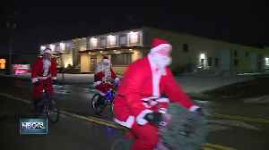 Nearly 60 Santas bike for a cause [Video]