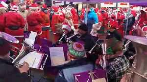 Hundreds don Santa suits for charity dash in Leeds in northern England [Video]