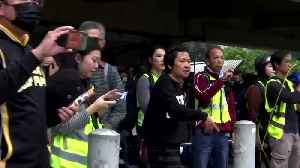 Police scuffle with protesters amid Hong Kong's Christmas shoppers [Video]