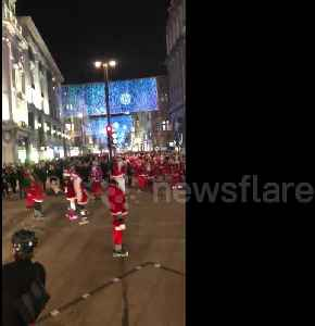 Roads in central London shut down by skating Santas [Video]