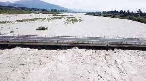 Flooded River Rises To Bridge's Roadway [Video]