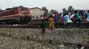 Crowd throw stones at train and vandalise station as Citizenship Act provokes protests across India [Video]