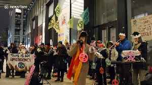 Eco-themed Christmas carols sung by climate activists outside Shell's London HQ [Video]