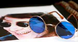 John Lennon's sunglasses sell for $183,000 at auction [Video]