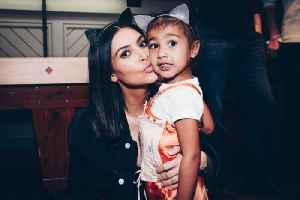 Kim Kardashian Had to Photoshop North West Into Christmas Card [Video]