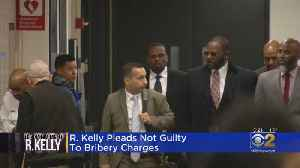 R. Kelly Pleads Not Guilty To Bribery [Video]