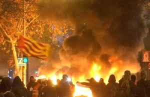 Fires rage as protesters attack police vans near Barca stadium [Video]