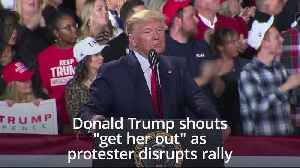 Trump yells 'get her out' as protester disrupts rally [Video]