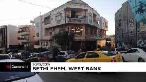 Artist Banksy unveils dark nativity in Bethlehem [Video]