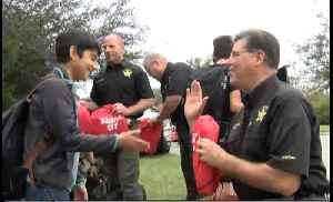 St. Lucie County Sheriff's Office delivers bags of presents to students at their bus stop for 'Santa Cop' program [Video]