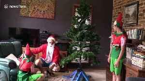 Santa dad zaps himself with homemade skill-tester Christmas tree [Video]