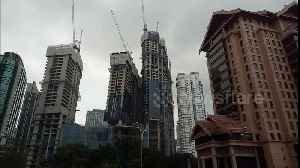 Kuala Lumpur's leaning tower isn't collapsing - it's SUPPOSED to look that way [Video]