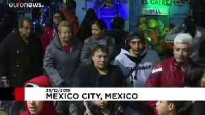 Mexicans visit giant baby Jesus statue to toast Christmas [Video]